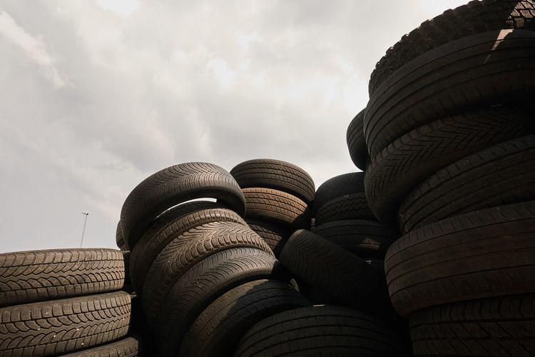 Low angle view of stack of building roof against sky