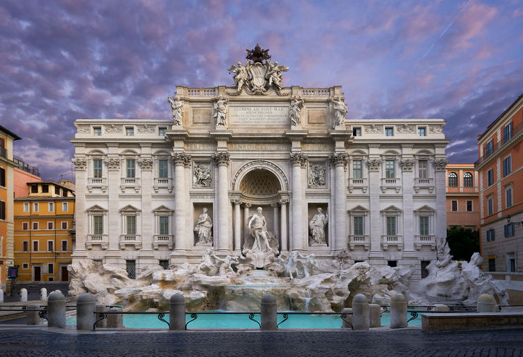 Trevi Fountain Against Cloudy Sky During Sunrise In City