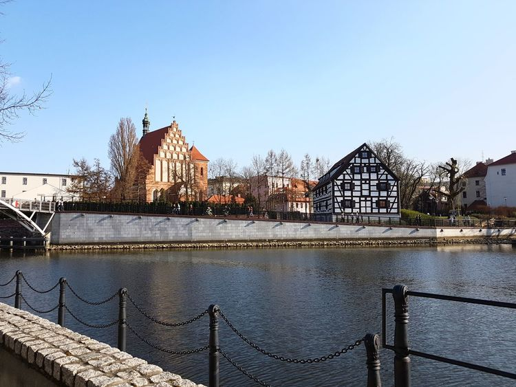 Bydgoszcz Travel Destinations Polandarchitecture Cultures Poland City Outdoors Sky Building Exterior Low Angle View Built Structure Architecture Reflection Water Architecture Travel Day River Bridge - Man Made Structure No People
