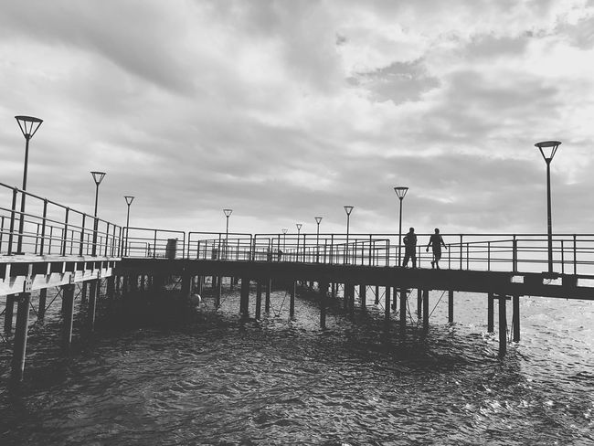 Walking People Lines Wharf Pier Art Beauty Clouds Sky Cloud - Sky Street Railing Street Light Nature Day Architecture Water Built Structure Sea Fence Tranquility No People City Barrier Transportation Boundary Outdoors
