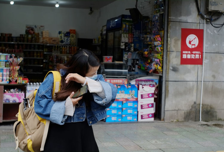 Woman standing at store
