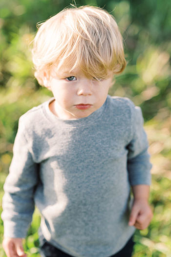 Portrait of cute boy standing outdoors