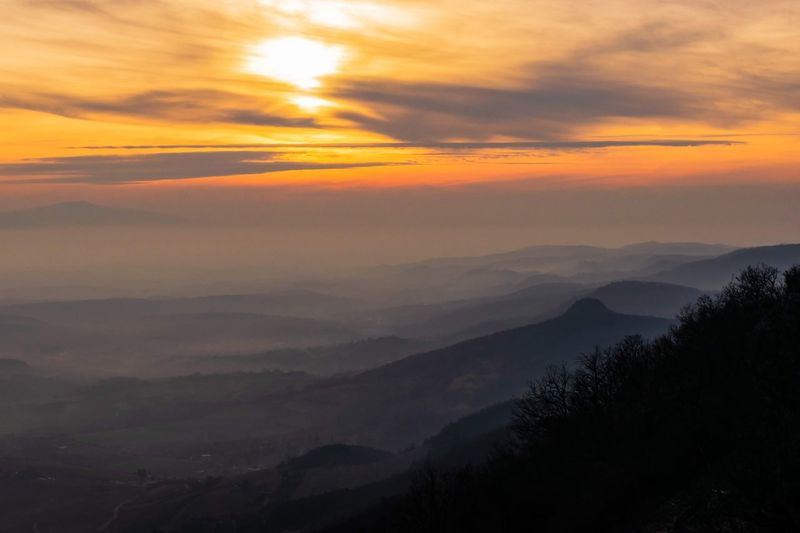Dusk colors. Sunset Golden Hour Dramatic Sky Mountain Sunset Beauty Fog Forest Multi Colored Tree Area Mountain Peak Mountain Ridge