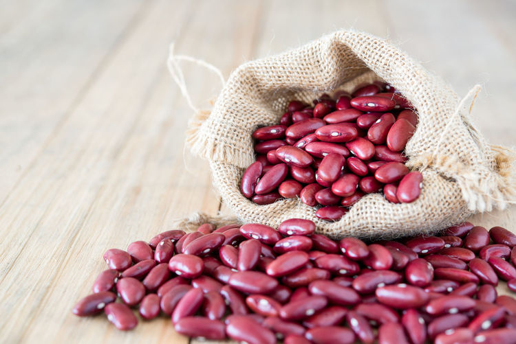 Close-Up Of Kidney Beans In Sack On Table