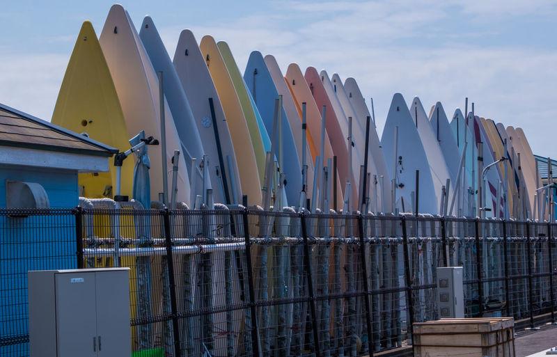 Panoramic shot of multi colored umbrellas on beach against sky