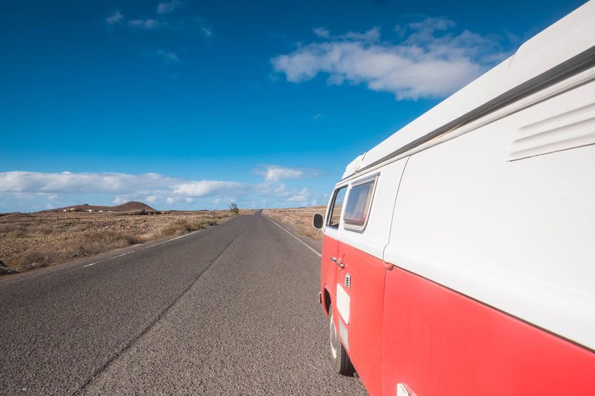 crossing canary island with a red old van Freedom Freedom! Fuerteventura Old Van Red Travel Vacations Asphalt Road Cloud - Sky Day Destinations Emotion Free Life Hippielife Lifestyles Mode Of Transport Mountain Nature No People Outdoors Positive Energy  Relaxing Moments Sky Transportation