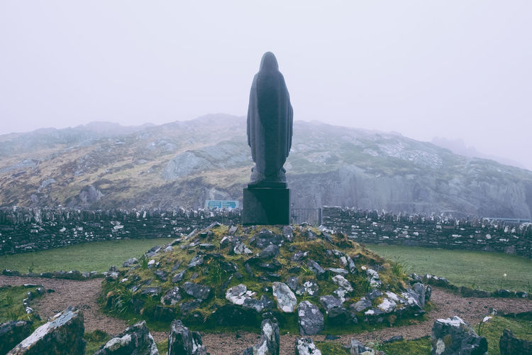 Ireland Beauty In Nature Day Fog Landscape Mountain Nature No People Outdoors Ring Of Kerry Scenics Sculpture Sky Statue
