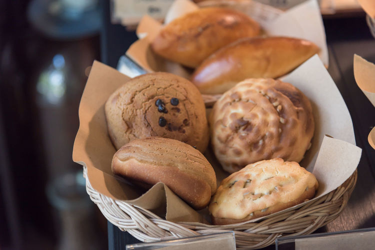 Variety of fresh bake bakery in Tokyo Japan. Baked Basket Bread Brown Bun Close-up Container Focus On Foreground Food Food And Drink French Food Freshness High Angle View Indoors  Indulgence Muffin No People Ready-to-eat Still Life Sweet Food Table Temptation Tray Wicker