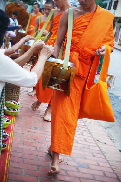 2017 Day Group Of People Laos Luang Phabang Luangprabang Men Morning Orange Outdoors Paindapatika People Real People Sanskrit Street World Heritage ラオス ルアンパバーン 御坊さん 托鉢 Monk  Temple Buddha Religion