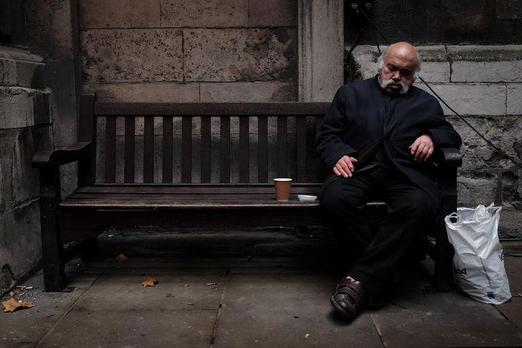 Full length of man sitting in park