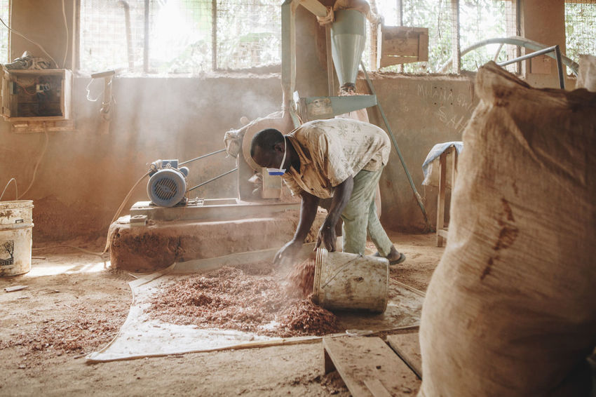 Adult Africa African Business Ceramic Clay Dirty Dust Factory Filter Indoors  Machinery Manual Labour Manual Worker Manufacturing Mask One Man Only Poor  Pottery Poverty Social Business Water Filter Woodchips Working Working Hard