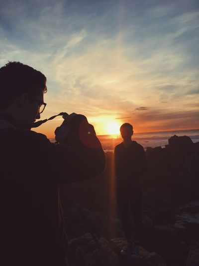 Beach Beauty In Nature Cloud - Sky Day Full Length Leisure Activity Lifestyles Men Nature Outdoors People Real People Rock - Object Scenics Silhouette Sky Standing Sunset Two People Young Adult EyeEmNewHere