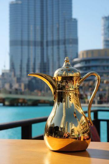 Burj Khalifa • Dubai Burj Khalifa Dubai United Arab Emirates Table No People Focus On Foreground Food And Drink Architecture Drink Close-up Sky Outdoors Day Building Built Structure Teapot