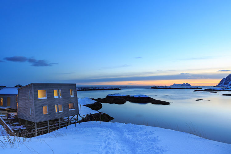 Landscape of Lafoten Islands at winter Lofoten Islands Norway Winter Architecture Beauty In Nature Building Building Exterior Built Structure Cloud - Sky Cold Temperature Landscape Nature Night No People North Northsea Outdoors Scenics - Nature Sea Sky Snow Sunset Tranquil Scene Tranquility Water Winter