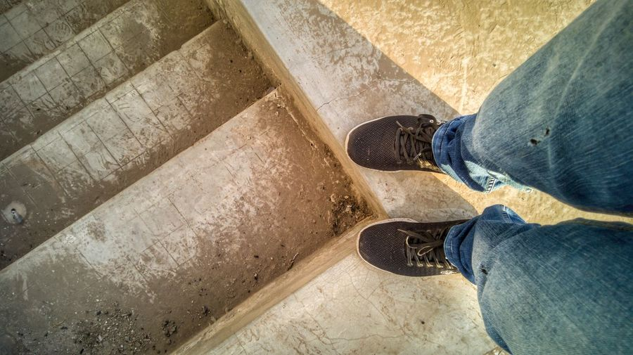 Low Section Standing Men Human Leg Shoe High Angle View Jeans Shadow Personal Perspective Close-up Trousers Footwear Human Foot Ground Feet Stone Tile Flat Shoe Human Feet Casual 17.62° My Best Photo The Art Of Street Photography