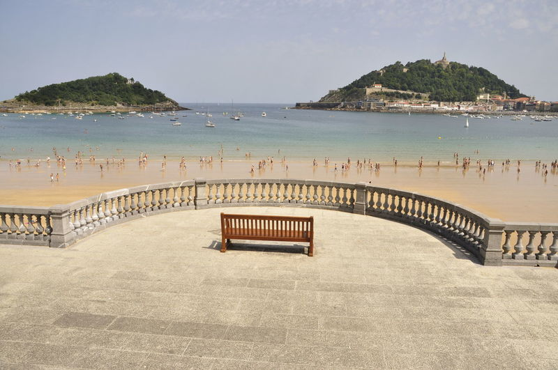 San Sebastian Waterfront Sea Architecture Beach Land Beauty In Nature Clear Sky Tranquility Scenics - Nature Sunlight Outdoors Water Sky
