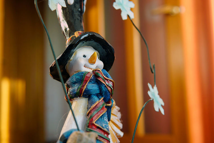 Close-up of snowman figurine during christmas