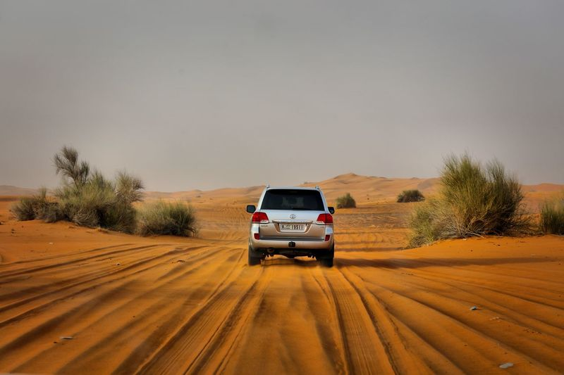 View Of Car In Desert Against Sky