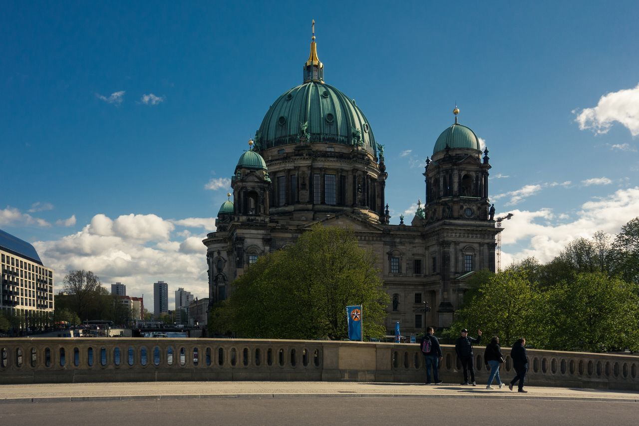 architecture, built structure, building exterior, dome, sky, cloud - sky, travel destinations, day, real people, outdoors, place of worship, travel, tourism, history, tree, large group of people, men, women, nature, city, people