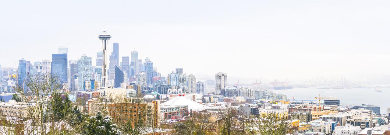 Buildings in city against clear sky
