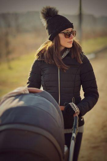 Woman pushing baby stroller
