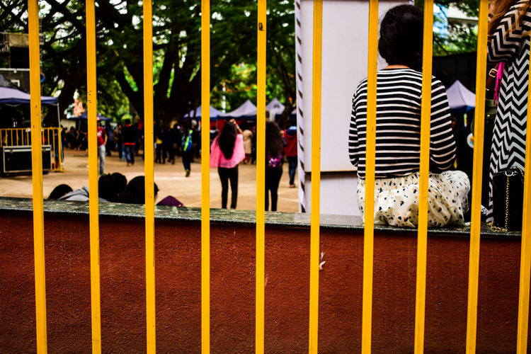 Behind bars, Sunlight Outdoors Building Exterior Built Structure Real People Music Streetphotography People Cultures Day Indian Street Photography Concert Photography