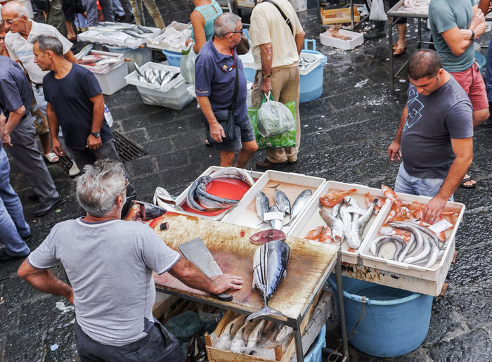 High angle view of people at fish market