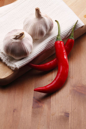 High angle view of red chili pepper on table
