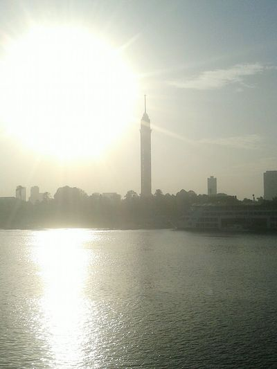 Cairo Tower .. Water Sky Built Structure Travel Destinations Tower No People Outdoors City Sunset Sunlight Sun Sunshine Nature Day Architecture River View The Architect - 2017 EyeEm Awards