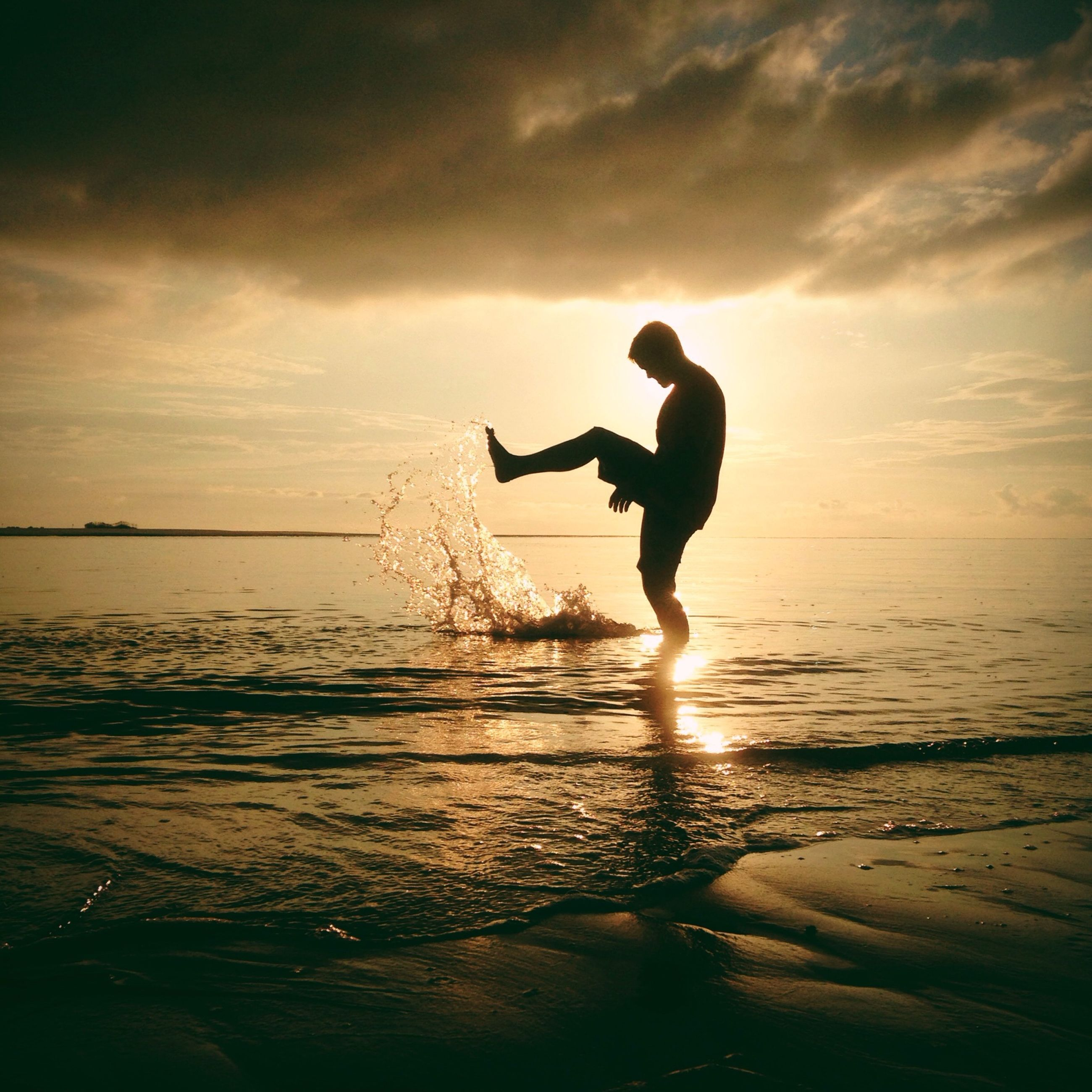 sea, full length, water, sky, lifestyles, leisure activity, sunset, beach, silhouette, horizon over water, shore, cloud - sky, jumping, scenics, tranquil scene, beauty in nature, mid-air, men