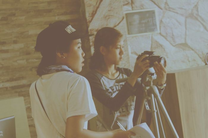 EyeEmNewHere girls director indie Film making & camera person Girls Jakarta INDONESIA Cafe Film Maker Film Making Videographer Director Director Of Photography Two People Young Adult Togetherness Females People Women Playing Indoors  Day Friendship Teamwork Women Around The World