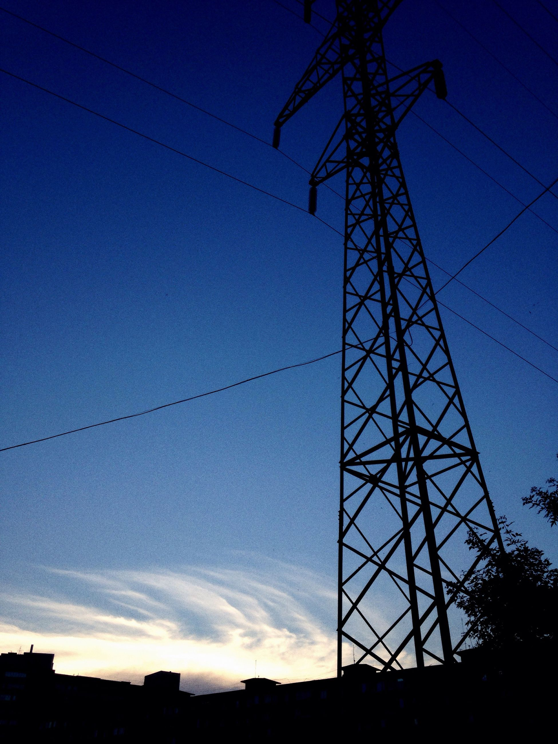 power line, low angle view, electricity pylon, electricity, power supply, silhouette, fuel and power generation, connection, technology, sky, cable, blue, dusk, built structure, sunset, power cable, architecture, outdoors, no people, building exterior