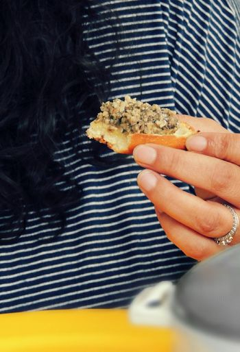 Close-up of cropped hand holding food