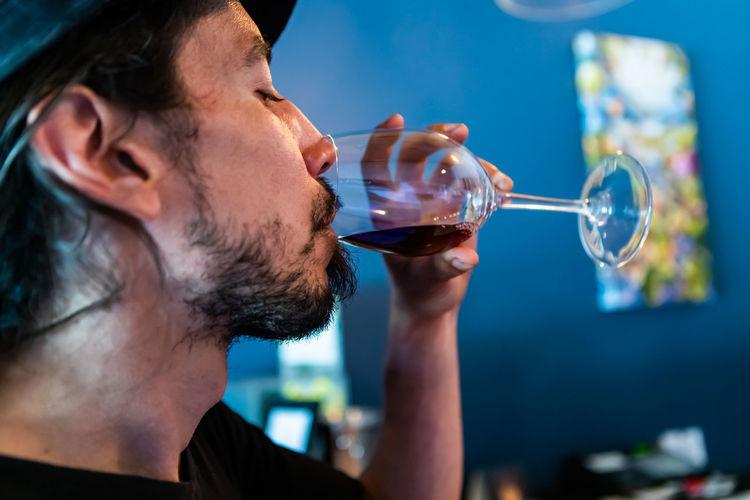 Close-up of man drinking wine