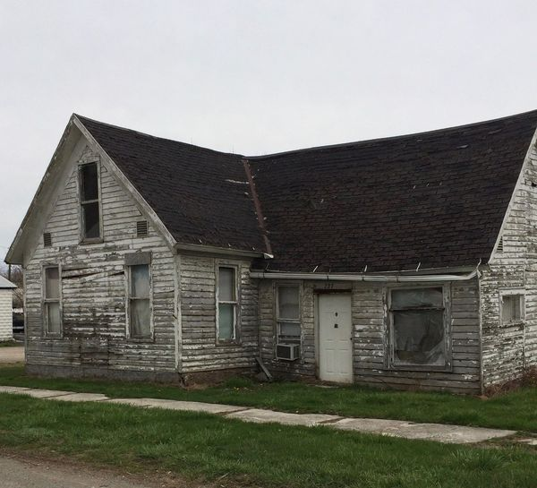 Abandoned falling down house Decay Vacant Abandoned Building Exterior Built Structure Clear Sky Countryside Day Decrepit Grass Haunted House Landscape Nature No People Old Outdoors Residential District Rickety Roof Roof Tile Rural Scene Sky Window