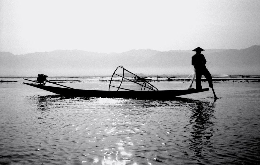 Water Real People Men Silhouette The Great Outdoors 2017 Eyeem Awards Transportation Nautical Vessel Mode Of Transport One Person Fisherman Full Length Waterfront Scenics Fishing Net Outdoors Sky Beauty In Nature Standing Lifestyles Inlay Lake Lac Inle Myanmar Birmanie Film Photography The Great Outdoors - 2017 EyeEm Awards Black And White Friday