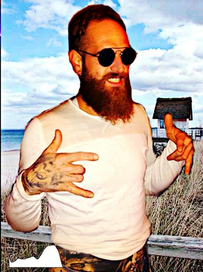Sunglasses Cloud - Sky Beard One Man Only One Person Only Men Tattoo Sky Macho Men Human Body Part Masculinity Art And Craft Real People Street Art East Germany Young Adult Beer Lover Beach Outdoors Standing Space Creativity Fun One Young Man Only