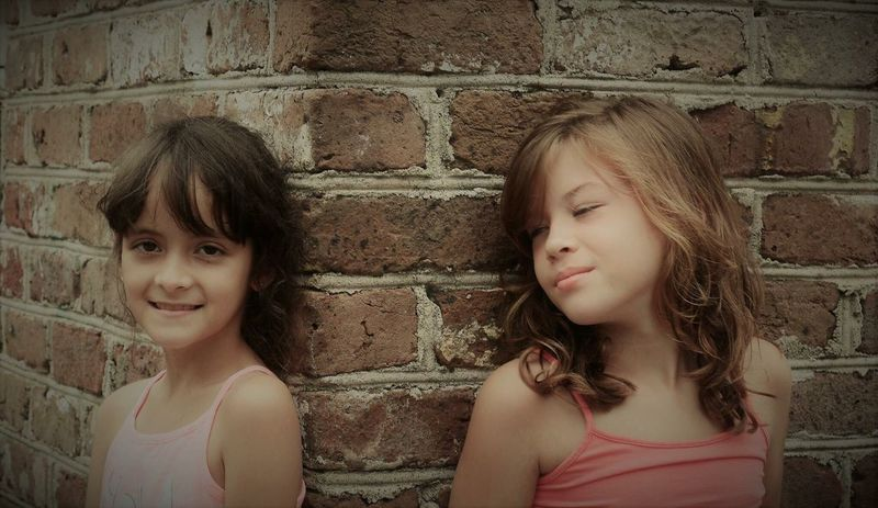 Americans Girls ! Charleston Sc . Childhood Girls Two People Brick Wall Real People Looking At Camera Portrait Sibling Child Togetherness Day Children Only Friendship Headshot Outdoors Bonding Smiling Close-up People Enjoyment Charleston South Carolina
