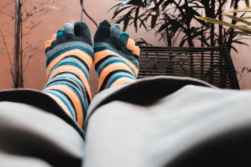 Leisure Activity Selective Focus Striped Personal Perspective Relaxing Take Five Take A Break Feet Up Home Office After Work Socks Lifestyles Relax