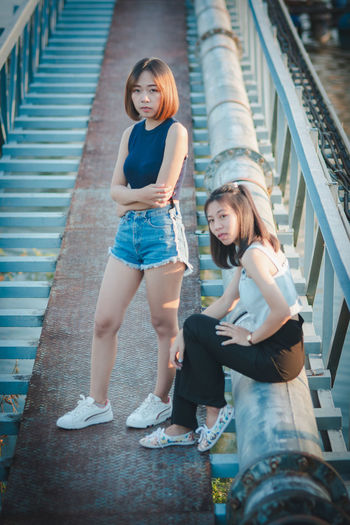 Asian Woman Asian Girl Asian Teen Casual Clothing Day Emotion Full Length Girls Hair Hairstyle Happiness Lifestyles Looking At Camera Outdoors People Portrait Real People Teenager Two People Women Young Adult Young Women