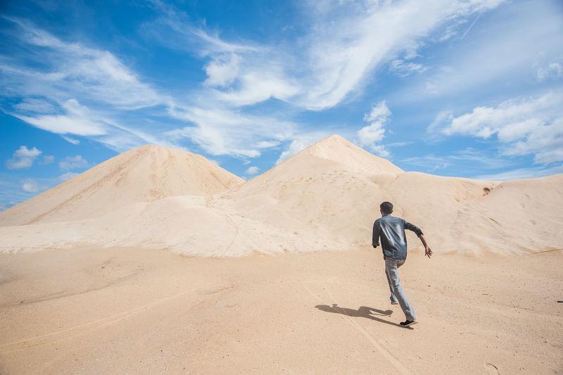 Rear View Of Man Running At Desert