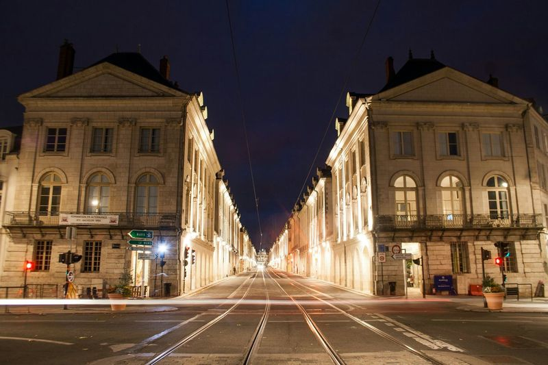 Follow the rails || Night Illuminated Architecture Long Exposure Light Trail City Outdoors Sky Travel Destinations Symmetry Building Exterior Building Buildings Architecture Architecture Architectural Detail French Tramway Lights Light And Shadow Orléans Orléans France France Nightphotography Night Lights No People