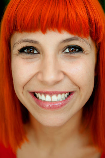 Portrait of smiling woman with dyed hair