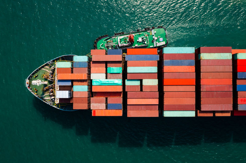 Aerial top view head shot from drone camera container cargo ship in import export