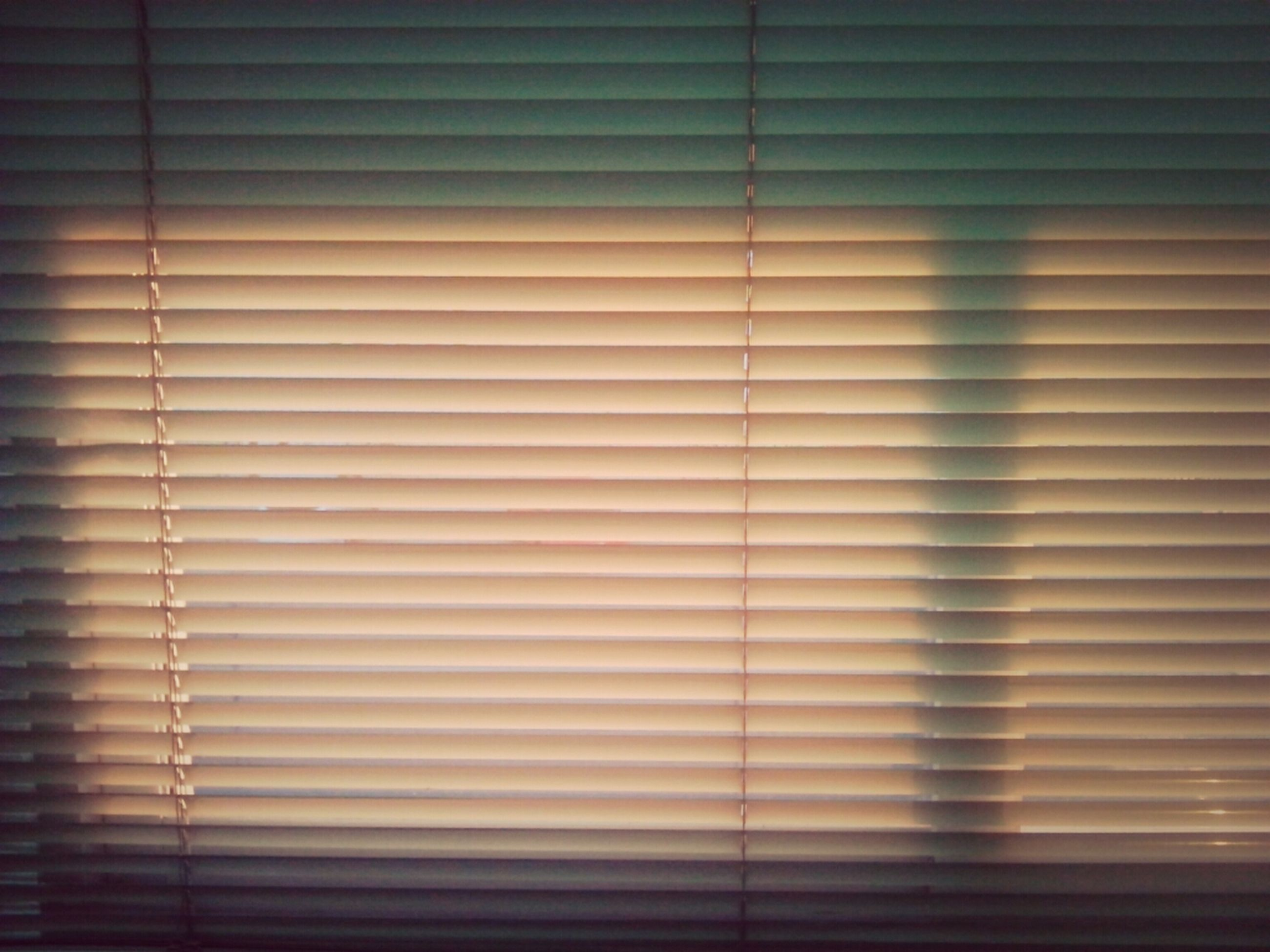 indoors, pattern, wall - building feature, blinds, curtain, full frame, wall, backgrounds, closed, window, built structure, architecture, no people, textured, home interior, shadow, close-up, repetition, shutter, illuminated