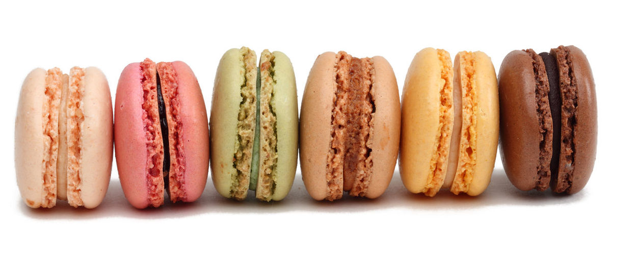 Macarons Dessert French Food Culture Macarons Macaroons Colorful Cut Out Cut Out On White Food Food And Drink French Food Freshness Homemade In A Row Ready-to-eat Studio Shot Sweet Food Traditional Food White Background