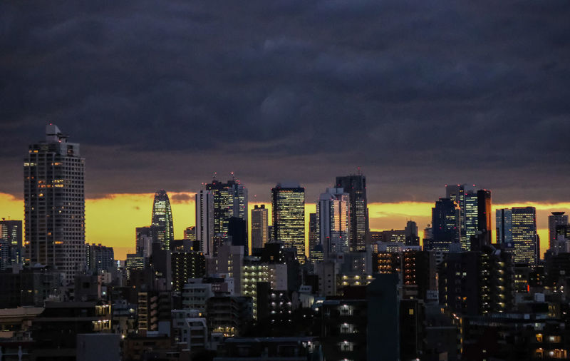 Tokyo buildings Architecture Building Exterior City Cityscape Cloud - Sky Cloudporn Dark Clouds Darkness And Light From My Point Of View From My Veranda No People Sky Skyscraper Tall Builds. Architectural Design The Buildings Tokyo Buildings Tokyo Night Urban Landscape Urban Skyline