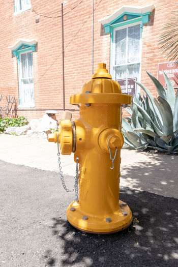Arizona Tucson Arizona  Architecture Building Building Exterior Built Structure Car Chrome Yellow City Day Fire Hydrant Footpath House Nature No People Outdoors Protection Safety Security Street Sunlight Transportation Yellow