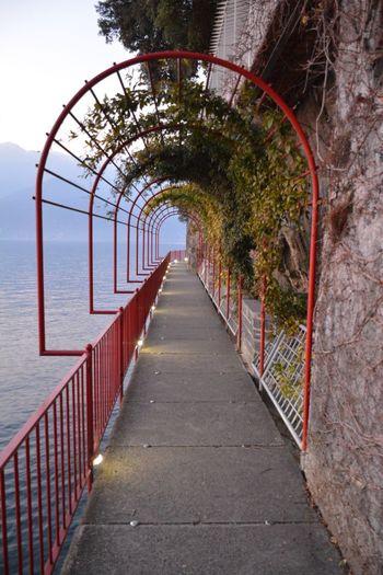 Empty footpath along sea