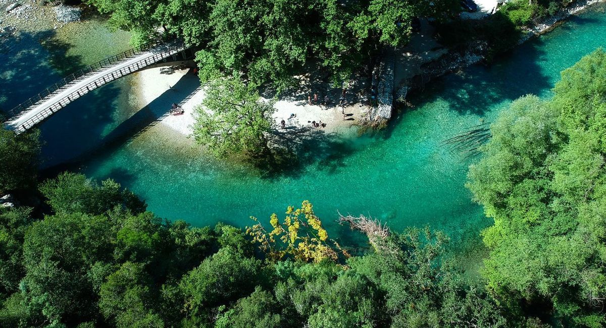 Voidomatis River Bridge Aerial View Greece River Shaolin Trekking Greece Zagoroxoria,greece Aerial Shot Voidomatis Green Water Water Nature Sea High Angle View Day Underwater Green Color Beauty In Nature No People Outdoors Tranquility Transparent The Great Outdoors - 2018 EyeEm Awards